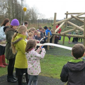 St Michael's school children cutting the ribbon for the bigger equipment