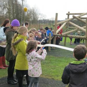 St Michael's school children cutting the ribbon for the bigger equipment